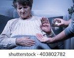 shot of a senior woman refusing ... | Shutterstock . vector #403802782