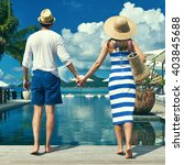 couple near poolside jetty at... | Shutterstock . vector #403845688