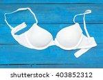 white bra lying on the aged... | Shutterstock . vector #403852312
