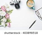 desk with coffee and flowers | Shutterstock . vector #403898518