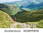 a hiker walking in the english... | Shutterstock . vector #403899898