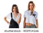 cute friends posing in studio | Shutterstock . vector #403914166