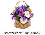 Flower Arrangement In A Wicker...
