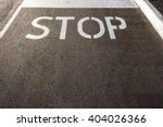 the word  'stop'  painted in... | Shutterstock . vector #404026366