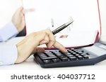 businesswoman analyzing graphic ...   Shutterstock . vector #404037712