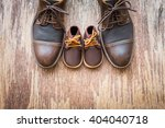 father and son brown shoes on... | Shutterstock . vector #404040718