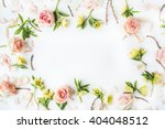 frame with pink roses  branches ... | Shutterstock . vector #404048512