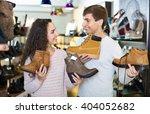 cheerful couple buying winter... | Shutterstock . vector #404052682