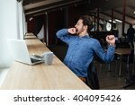 man sitting at the table with...   Shutterstock . vector #404095426