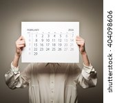 woman is holding february...   Shutterstock . vector #404098606