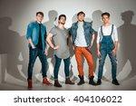 group of young attractive men... | Shutterstock . vector #404106022