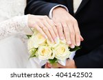 hands of the groom and the... | Shutterstock . vector #404142502