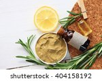Small photo of Cosmetic clay facial mask, rosemary oil and herbs, lemon. Body wrap domestic treatment. Top view.