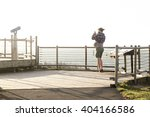 a tourist taking pictures at a... | Shutterstock . vector #404166586