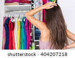 home closet indecision woman... | Shutterstock . vector #404207218