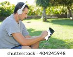 young man relaxing with a... | Shutterstock . vector #404245948