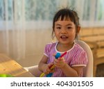 asian toddler girl in happy... | Shutterstock . vector #404301505