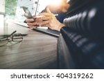 designer hand working with... | Shutterstock . vector #404319262