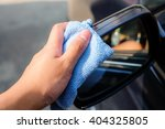 hand wash a wing mirror with...   Shutterstock . vector #404325805