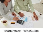aged couple working with... | Shutterstock . vector #404353888