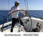 young man sailing yacht... | Shutterstock . vector #404387482