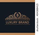calligraphic luxury line logo...   Shutterstock .eps vector #404388415