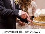 couple cutting their wedding... | Shutterstock . vector #404395138