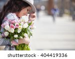 woman with tulips. beautiful... | Shutterstock . vector #404419336