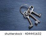 bunch of keys on dark background | Shutterstock . vector #404441632