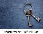 bunch of keys on dark background | Shutterstock . vector #404441635