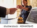 Stock photo guest takes room key card at check in desk of hotel close up 404449645