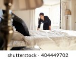 chambermaid changing bed linen... | Shutterstock . vector #404449702