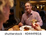 senior couple eating meal in a... | Shutterstock . vector #404449816