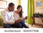 young couple read a guide... | Shutterstock . vector #404457508