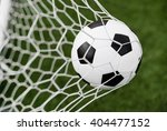 soccer ball in goal net with... | Shutterstock . vector #404477152