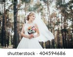 the bride in a white dress   Shutterstock . vector #404594686