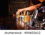 Small photo of Bartender works with tools on bar at the night club