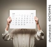 woman is holding june calendar...   Shutterstock . vector #404704996
