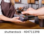 costumer scanning phone to pay | Shutterstock . vector #404711398