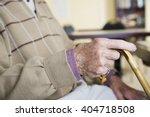an elderly man holding a... | Shutterstock . vector #404718508