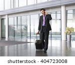 a businessman wheeling a... | Shutterstock . vector #404723008