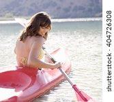 a woman in a kayak | Shutterstock . vector #404726308