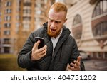 angry ginger man screaming on... | Shutterstock . vector #404751202