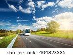 bus on asphalt road in... | Shutterstock . vector #404828335