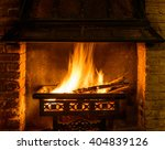 a log fire in a chimney | Shutterstock . vector #404839126