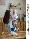 mother with her baby daughter... | Shutterstock . vector #404876866