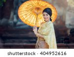 woman wearing typical thai... | Shutterstock . vector #404952616