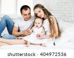 mother and father with little... | Shutterstock . vector #404972536