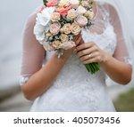 bride holding wedding bouquet... | Shutterstock . vector #405073456