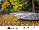 Small photo of Stored canoes and fall foliage in the Appalachian Mountains